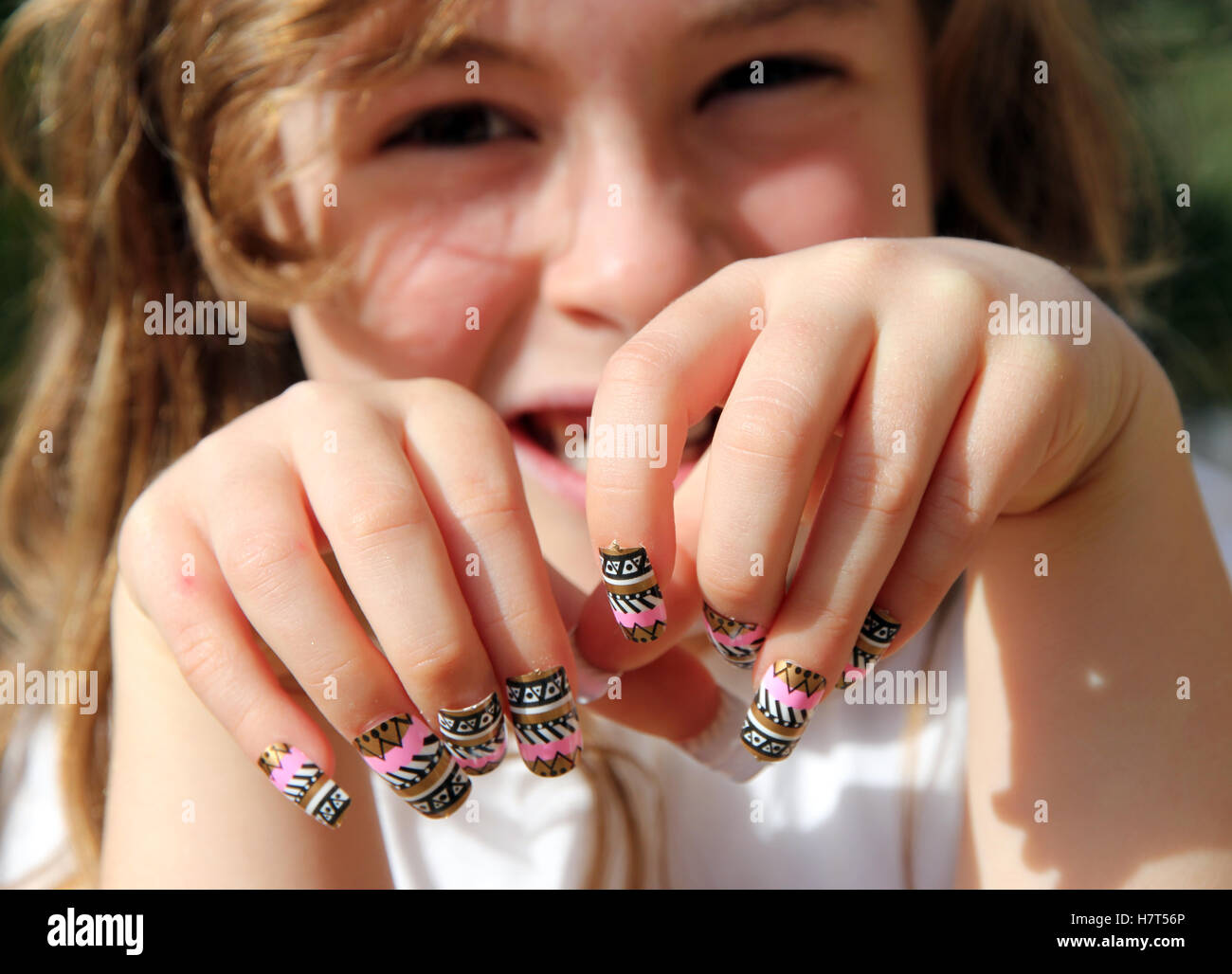 fake nails on young girl\'s fingers Stock Photo: 125306126 - Alamy