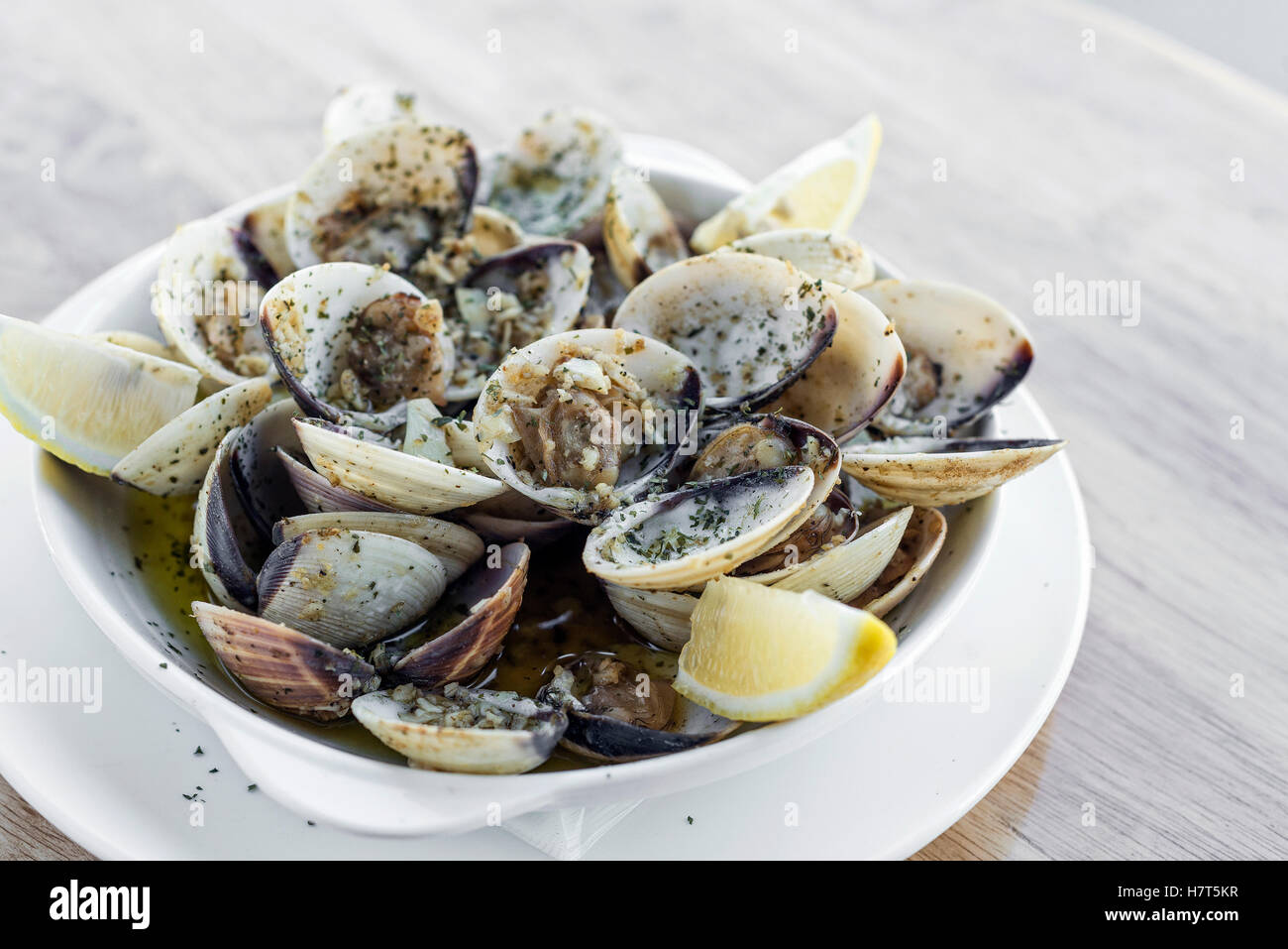 garlic white wine steamed fresh clams seafood tapas simple snack ameijoas bulhao pato portuguese style - Stock Image