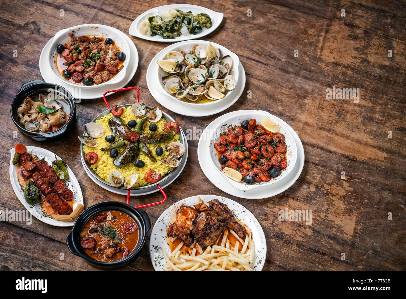 mixed portuguese traditional rustic tapas famous food selection on wood table - Stock Image