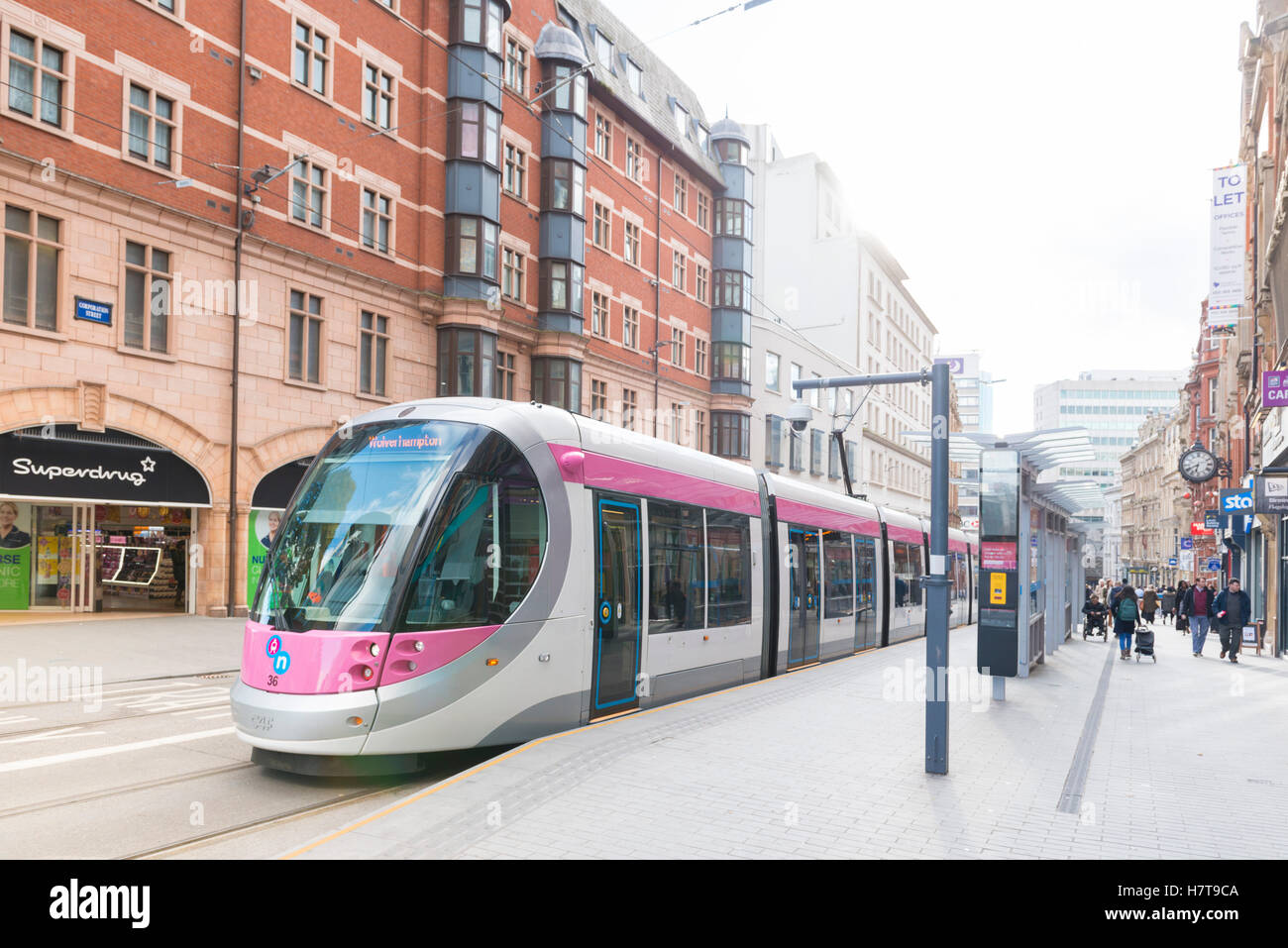 A tram in Birmingham City Centre, England. Corporation Street. - Stock Image