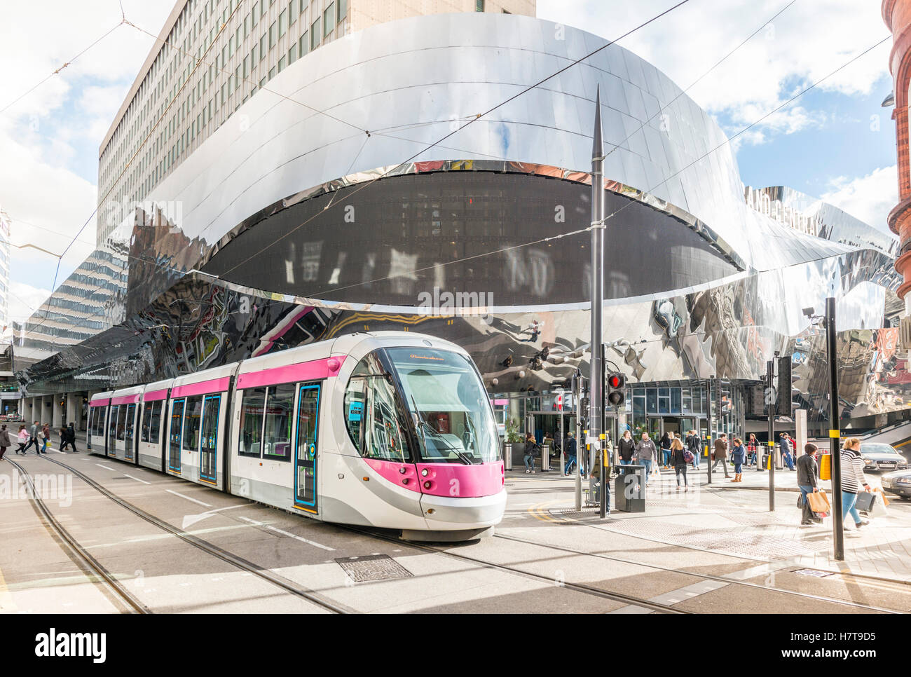 A tram in Birmingham City Centre alongside New Street train station, England. Editorial usage only. - Stock Image