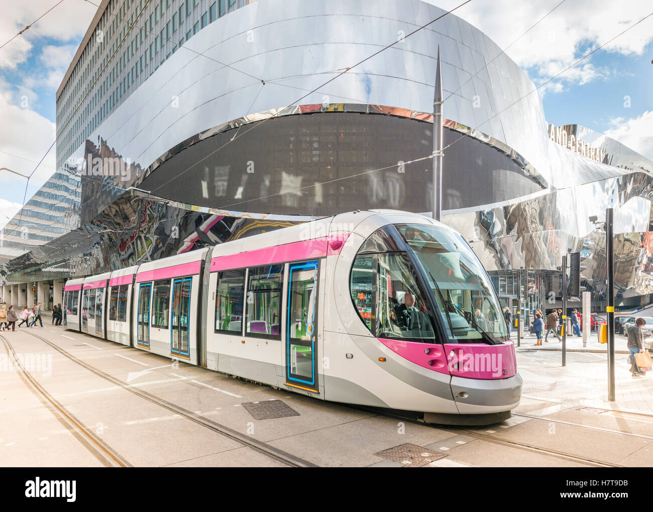 A tram in Birmingham City Centre alongside New Street train station, England. Editorial usage only. Stock Photo