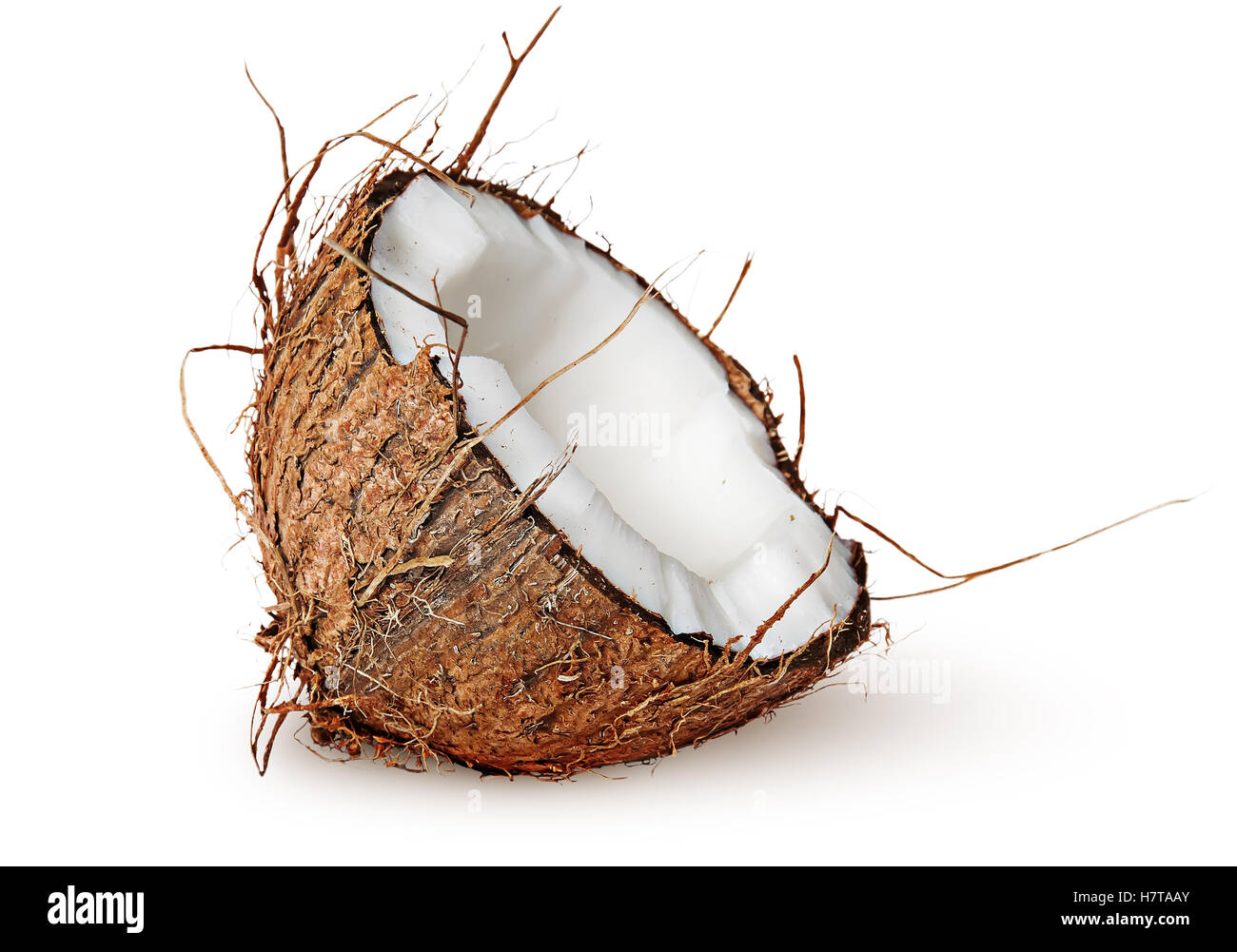 Half coconut rotated isolated on white background - Stock Image