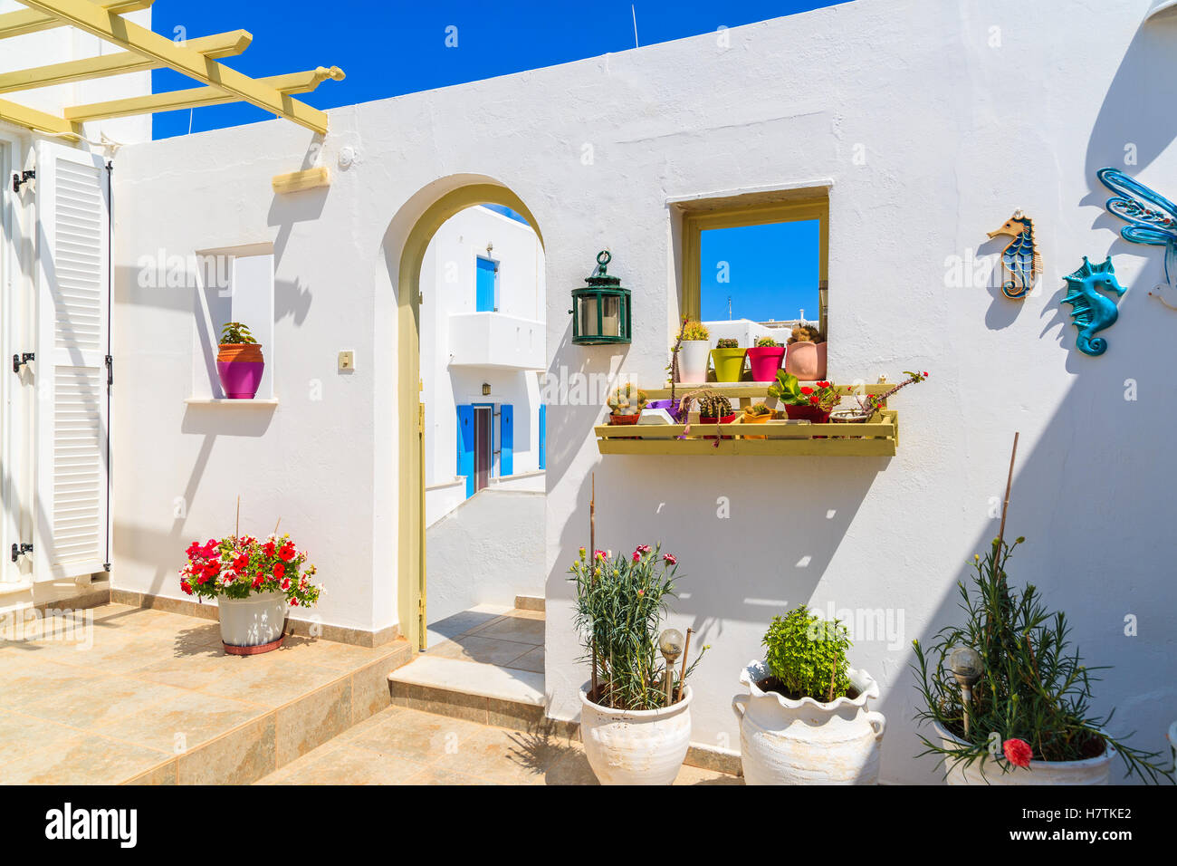 Entrance gate to typical Greek style apartments decorated with ...