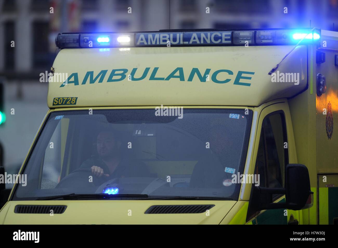 An ambulance with its flashing blue lights on during an emergency. - Stock Image