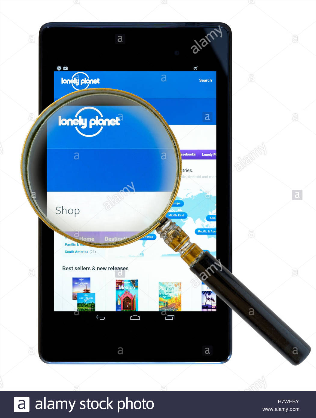 Lonely Planet travel guides shown on a tablet computer, Dorset, England, UK - Stock Image