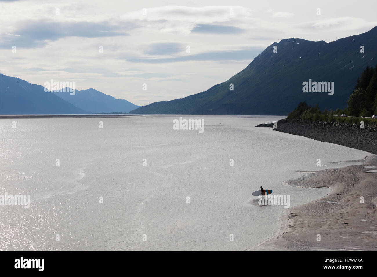9ade13f9f A man paddle-boards out in Turnagain Arm in Southcentral Alaska ...