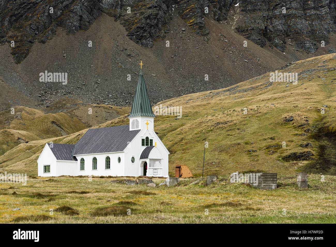 White church building with steeple and cross; Grytviken, South Georgia, South Georgia and the South Sandwich Islands, - Stock Image