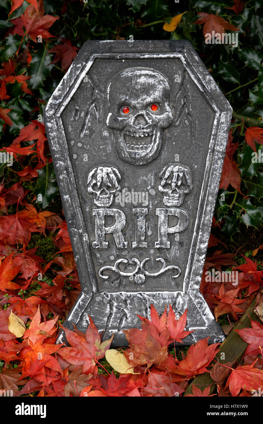 Halloween tombstone decorated with skulls and rest in peace RIP lettering, Vancouver, BC, Canada - Stock Image