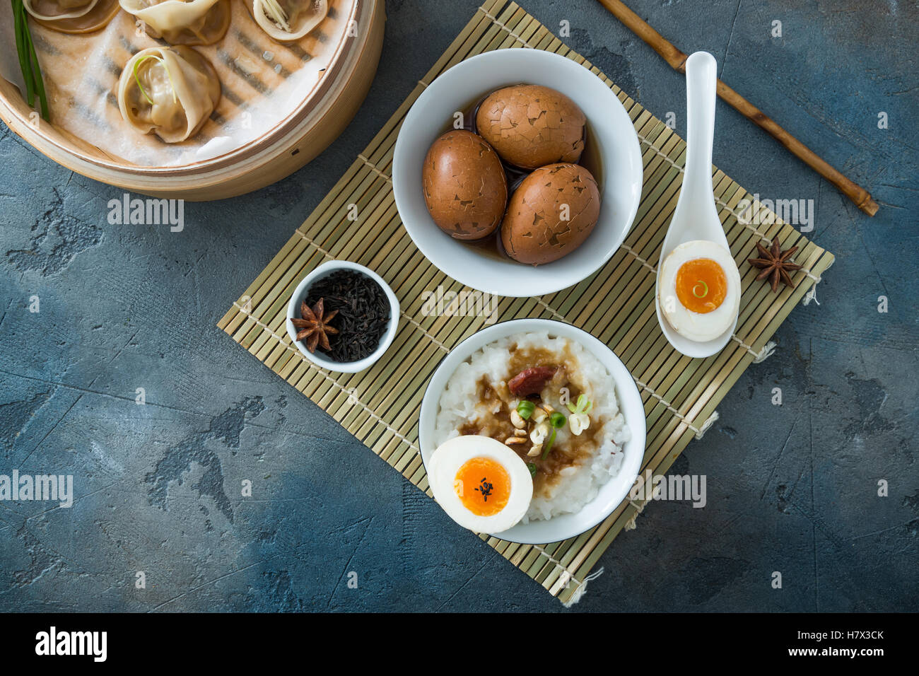 Chinese Streamed Dumpling with tea eggs and porrige Stock Photo