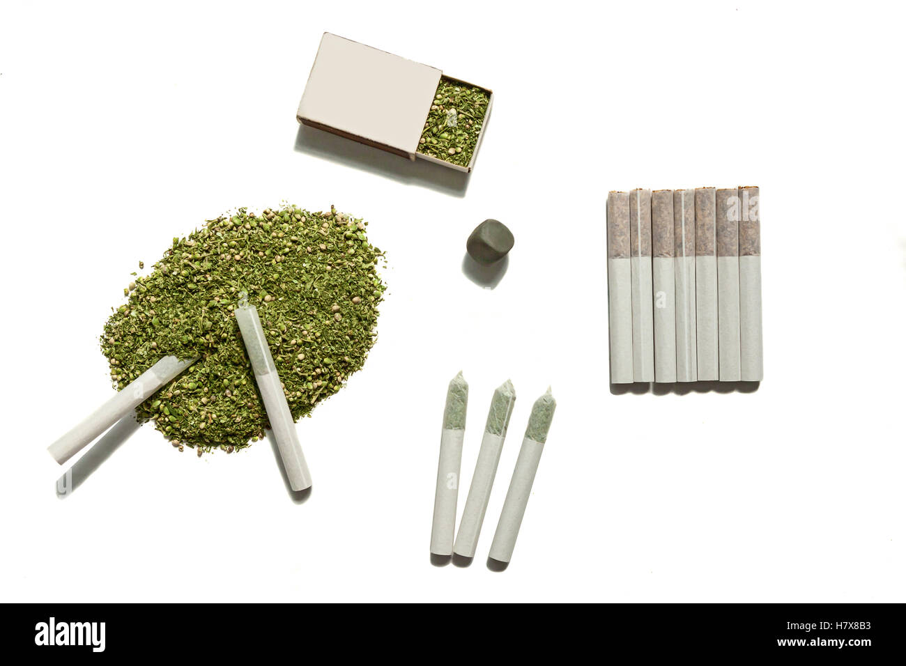 Weed for smoking.The cannabis filled in the box, the pile on the table with two rolled cigarettes of hemp, seven - Stock Image