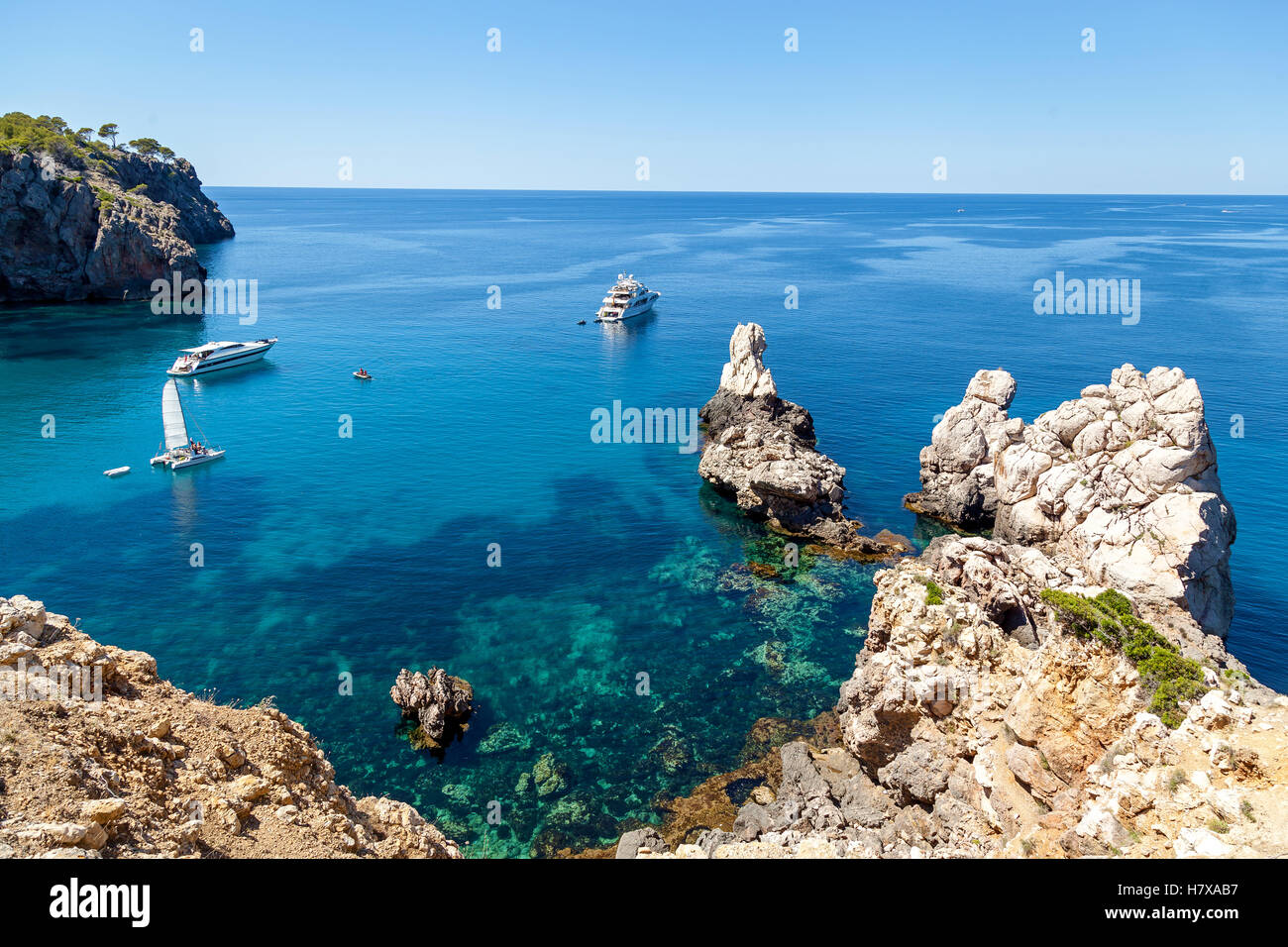 Azure bay with crystal clear water, which offers incredible views of the vast expanses. Lonely sailer rock on the - Stock Image