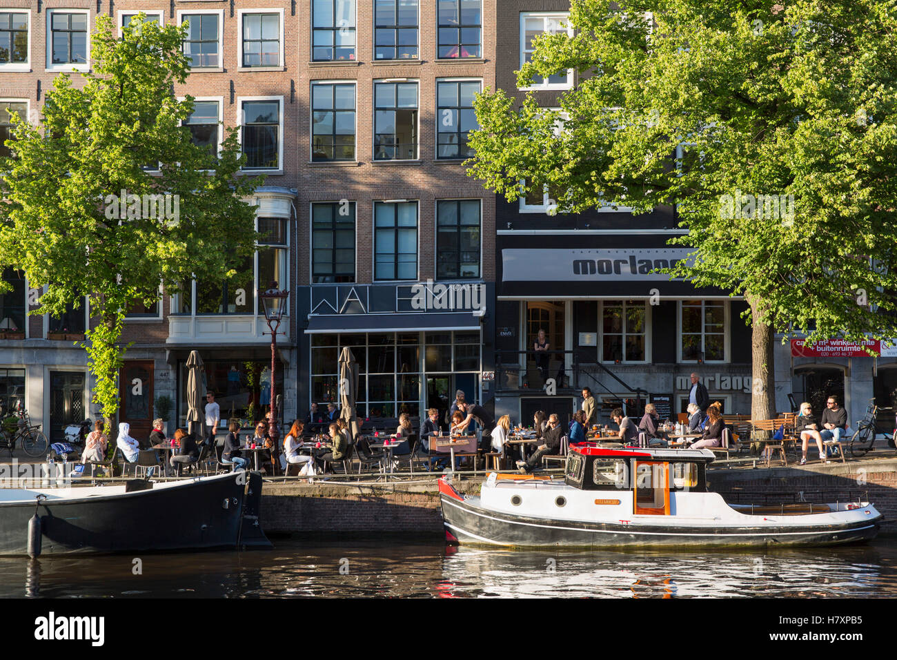 Outdoor cafes on Prinsengracht canal, Amsterdam, Netherlands - Stock Image
