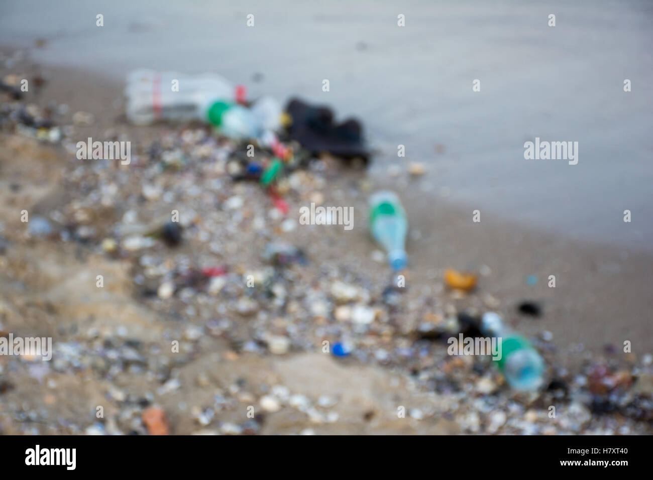 Pollution at the beach with blurred background - Stock Image