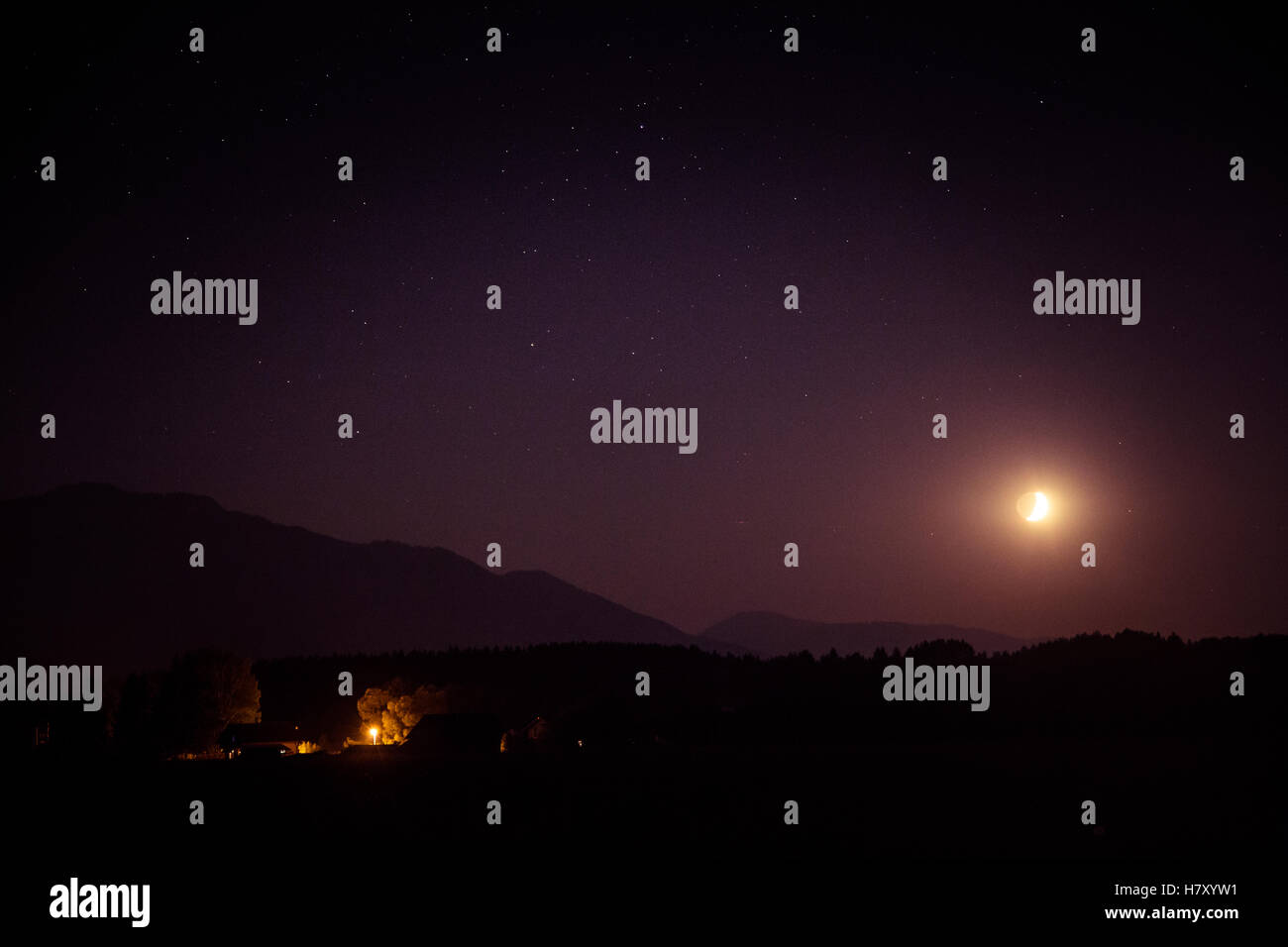 A beautiful moon above the mountains - Stock Image