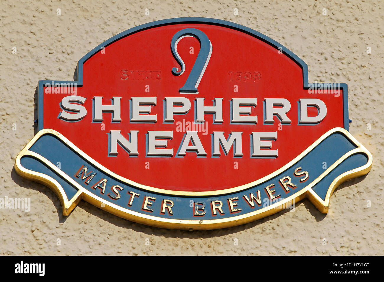 A plaque bearing the Shepherd Neame brewery logo - Stock Image