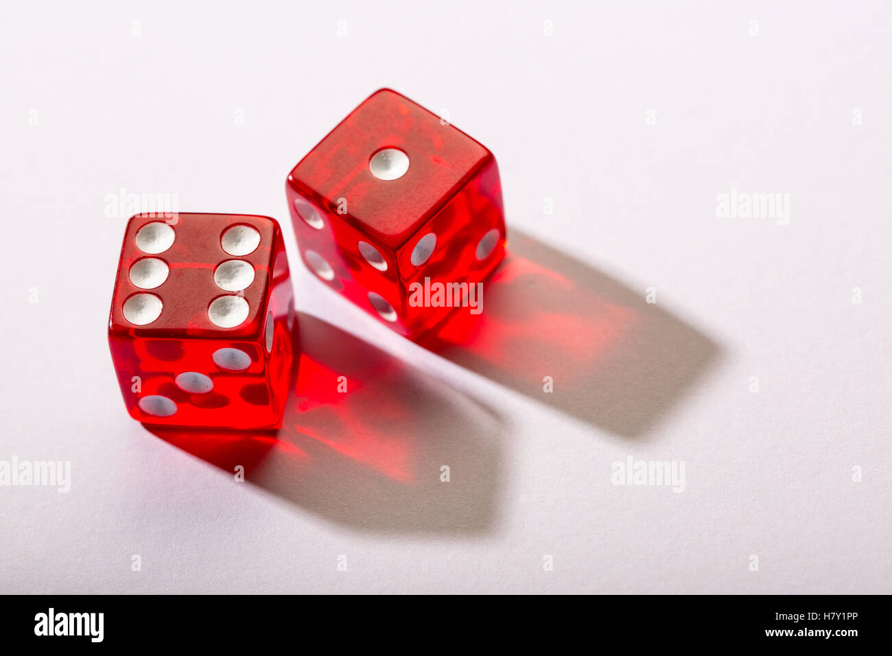red dice against a white background - Stock Image