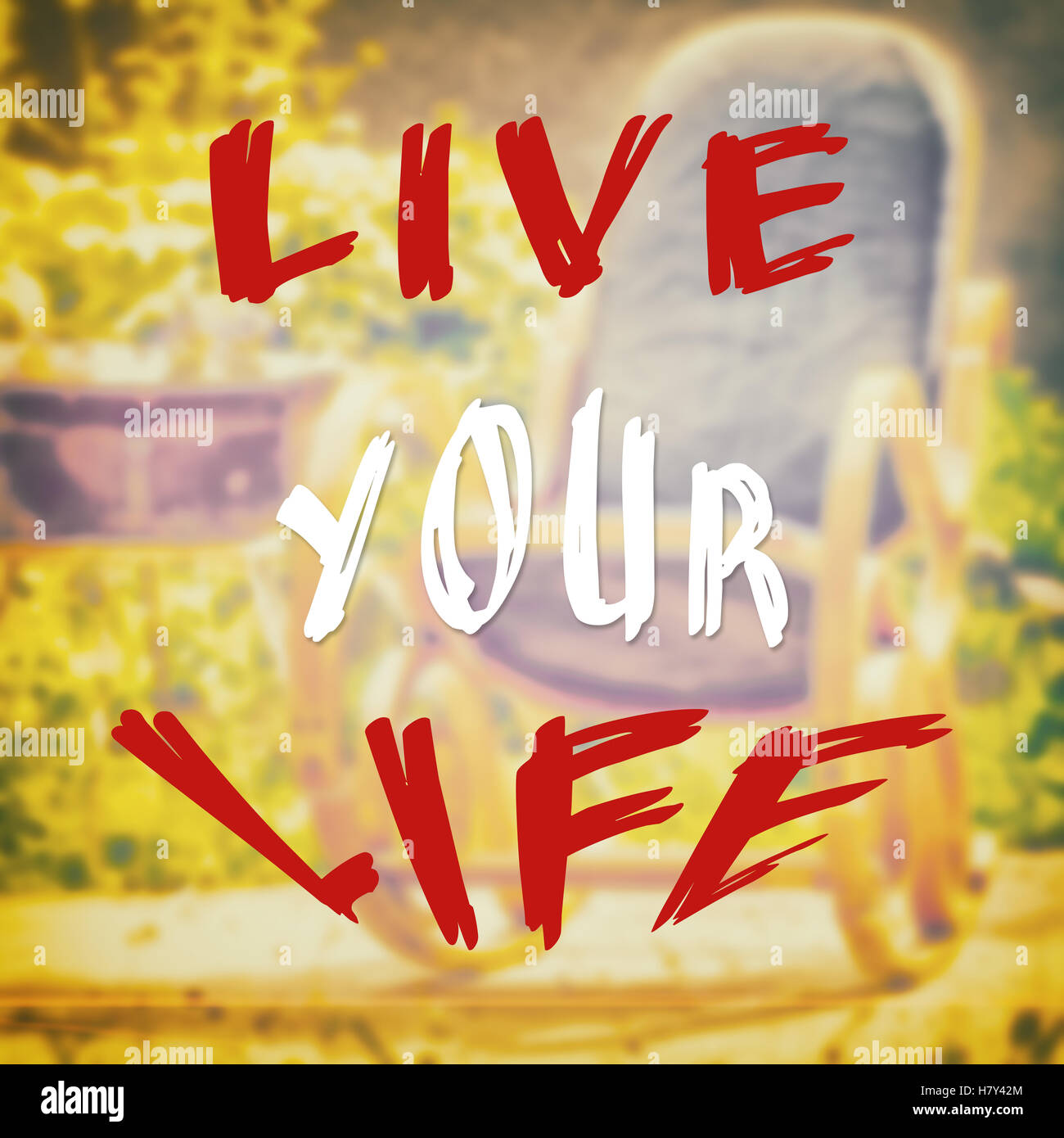 Motivational and optimistic quote with live your life text on filter wallpaper - Stock Image