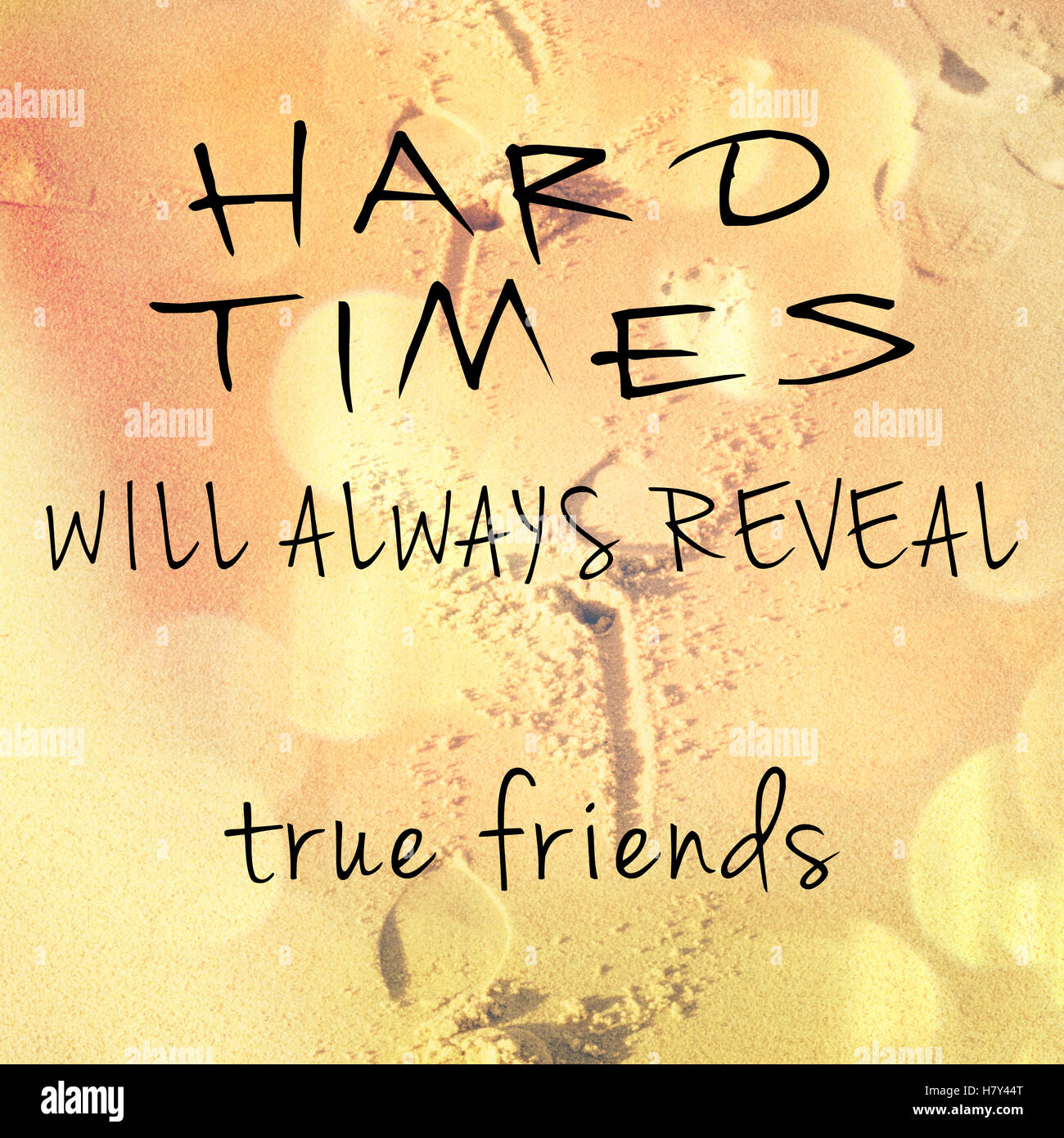 Inspirational typographic quote about friendship on blurred background - Stock Image
