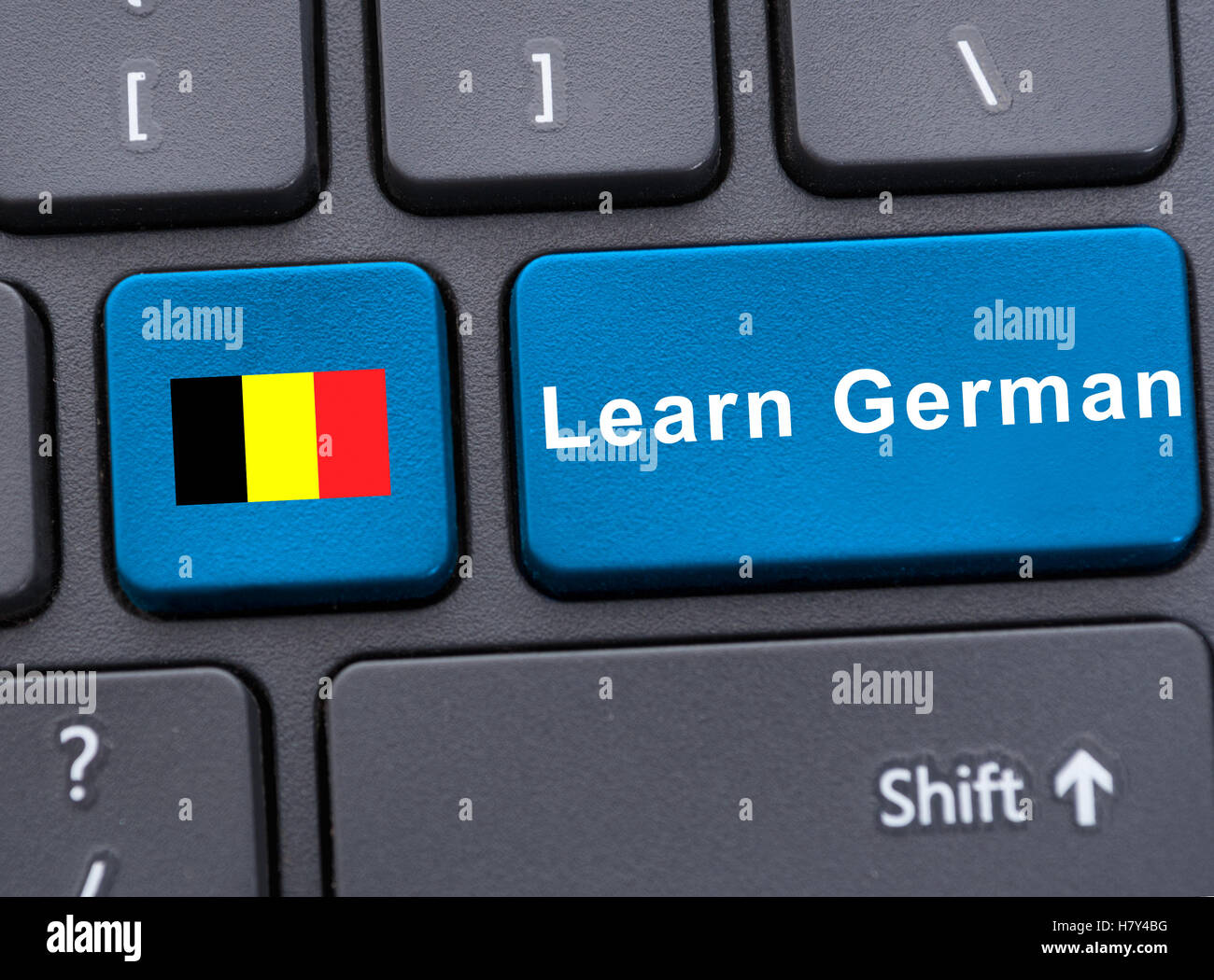 Closeup key with deutsch flag and learn german button on keyboard - Stock Image