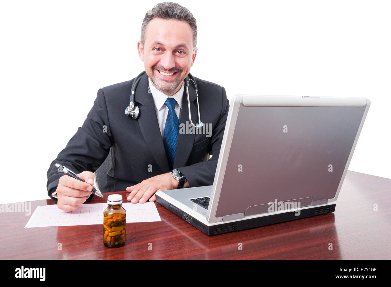 Smiling doctor at office writing diagnosis or prescription isolated on white background - Stock Image