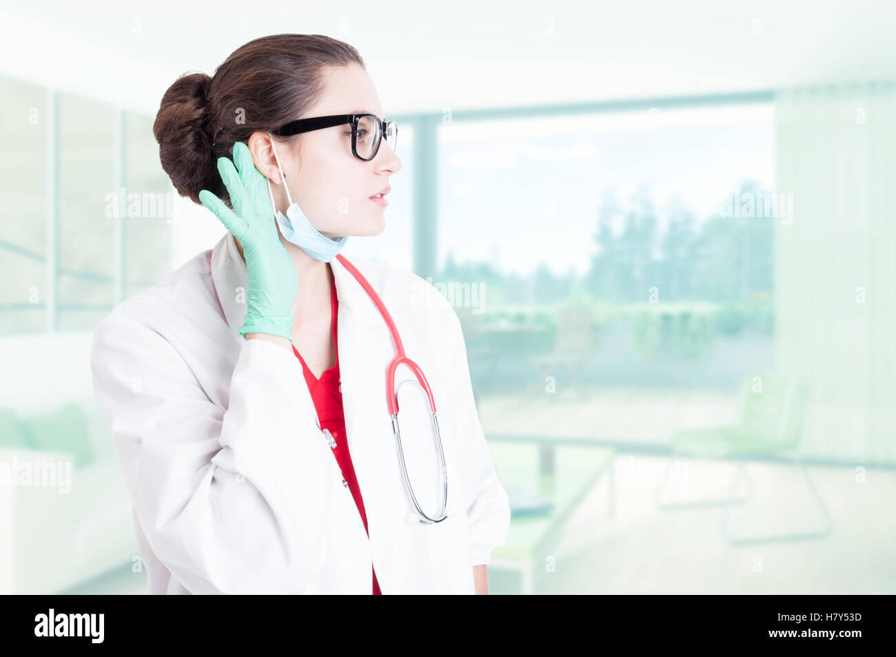 Professional medic listening latest news or gossips at the job with text area - Stock Image