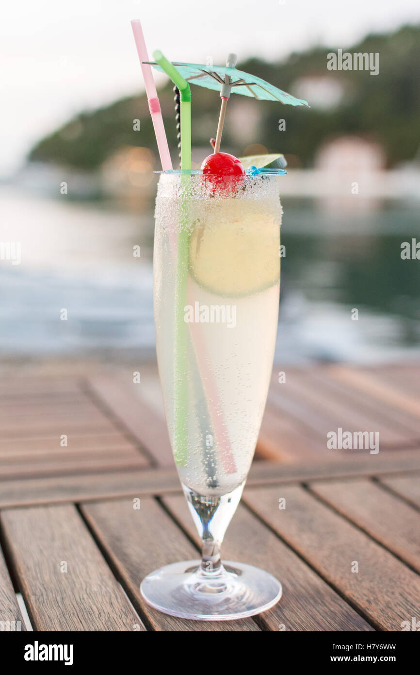 Gin Fizz cocktail with sugar rim - early evening in Lakka, Paxos, Greece, Europe - Stock Image