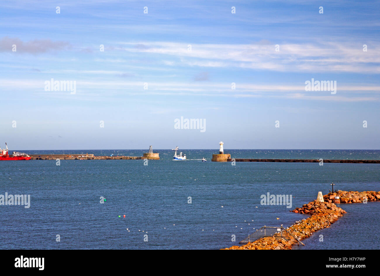 A view of the harbour entrance and breakwaters at Peterhead, Aberdeenshire, Scotland, United Kingdom. - Stock Image