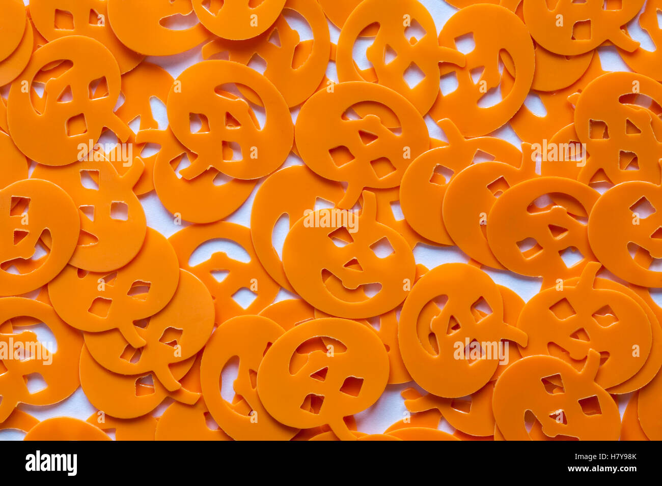 Halloween Mystical Confetti - pumpkins faces decorations spread out - Stock Image