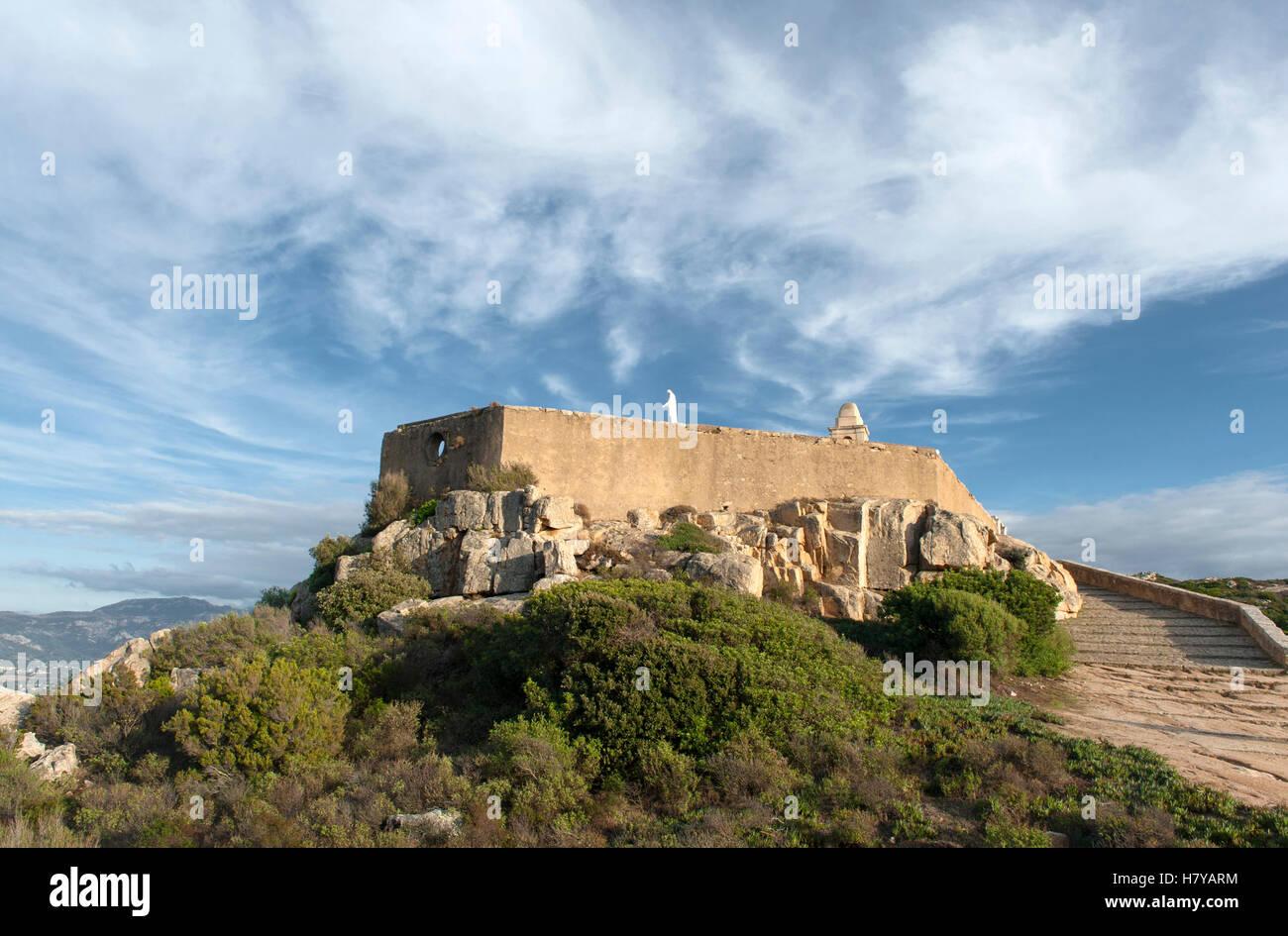 The small chapel of Notre Dame de la Serra on the rocks above the town of Calvi, Haute-Corse, France - Stock Image