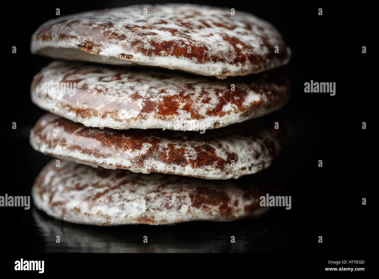Round Lebkuchen on black background - Stock Image