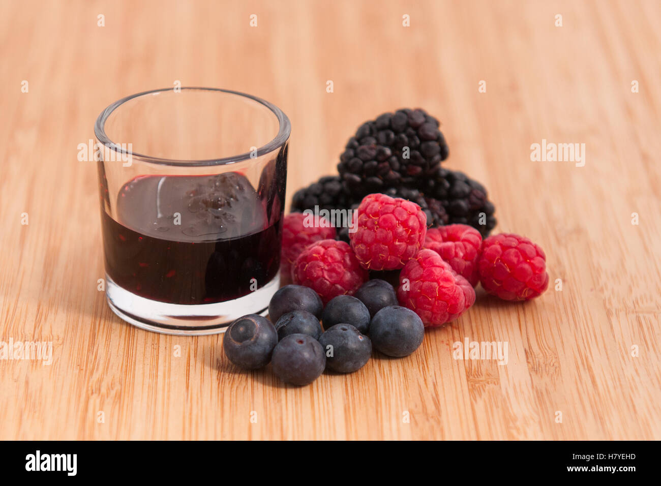 Natural flavored liquid for pastry of red fruits - Stock Image