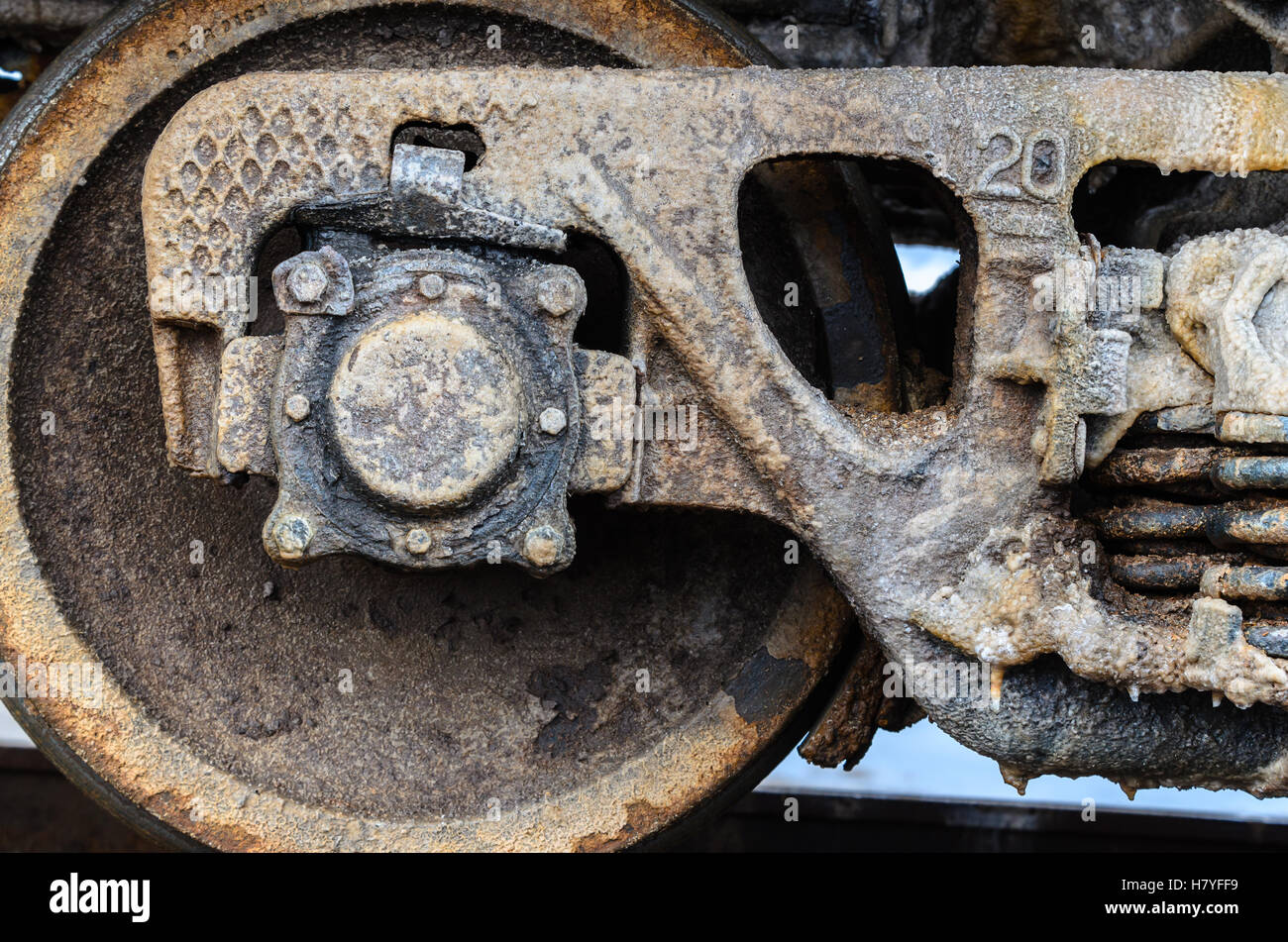 Train rusty wheels covered by salt of Baskunchak lake, Russia. It is stains on railroad carriage's surface . Close Stock Photo