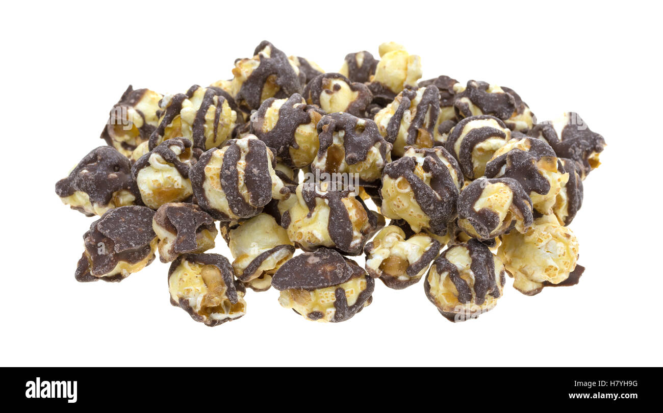 Side view of a serving of fudge drizzled popcorn isolated on a white background. - Stock Image