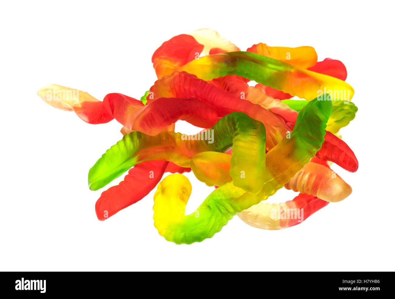 A group of colorful gummy worms isolated on a white background. - Stock Image