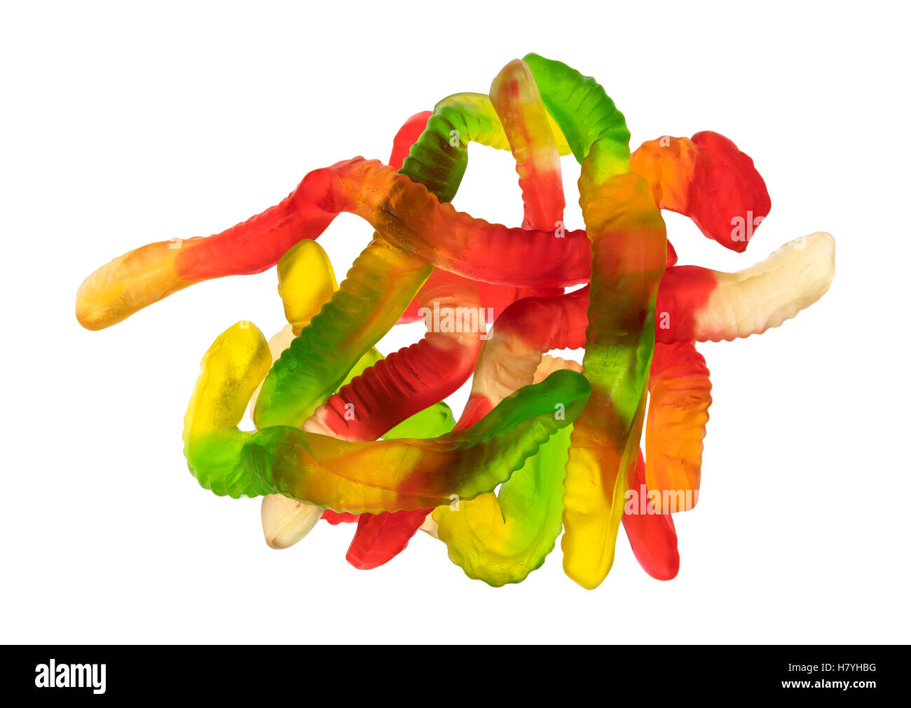 Top view of a group of colorful gummy worms isolated on a white background. - Stock Image