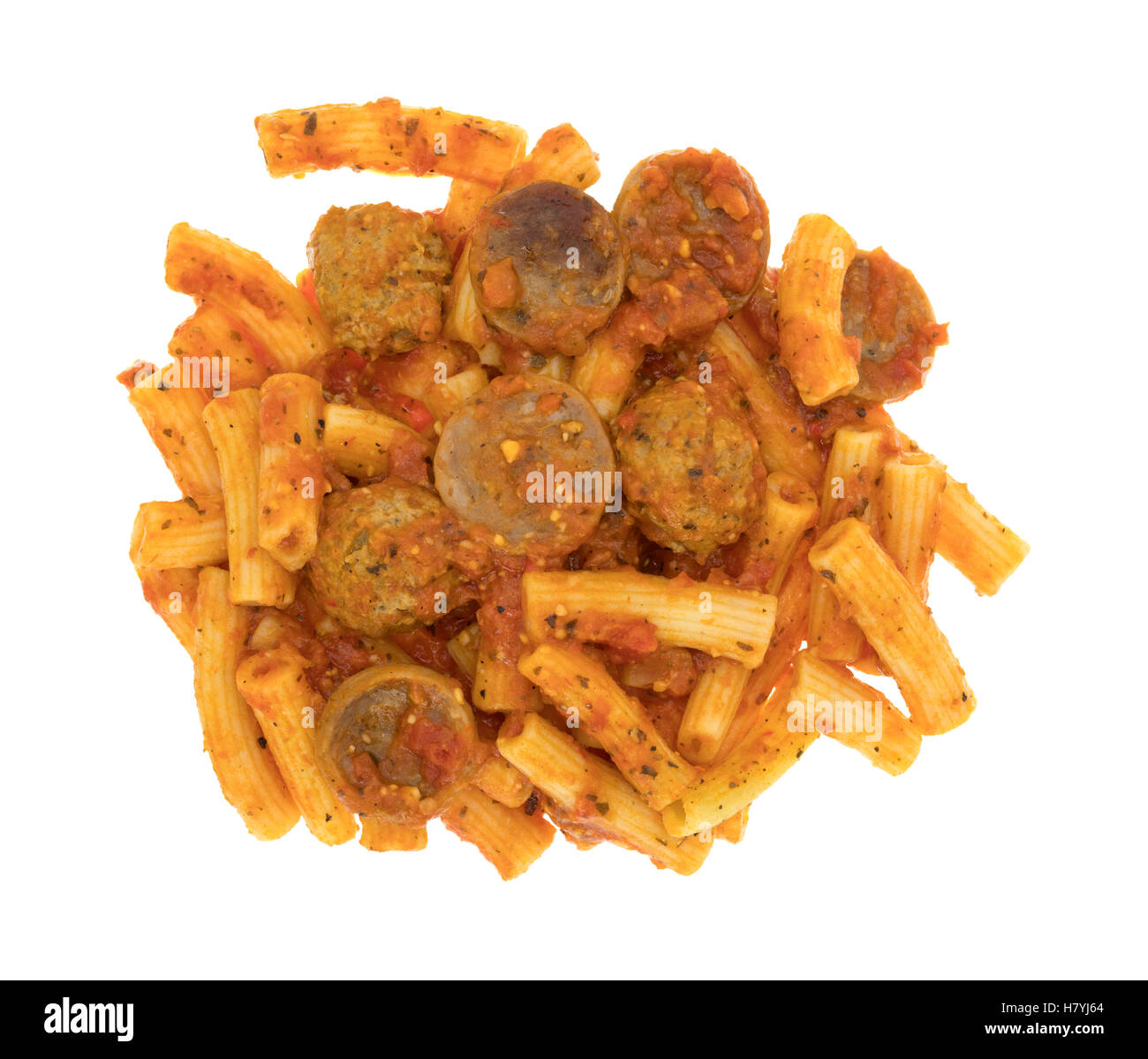Top view of a portion of rigatoni pasta with sausage and meatballs in a marinara sauce isolated on a white background. Stock Photo