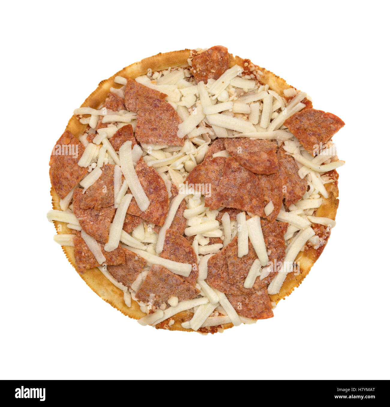 Top view of a frozen pepperoni pizza with mozzarella cheese isolated on a white background. - Stock Image