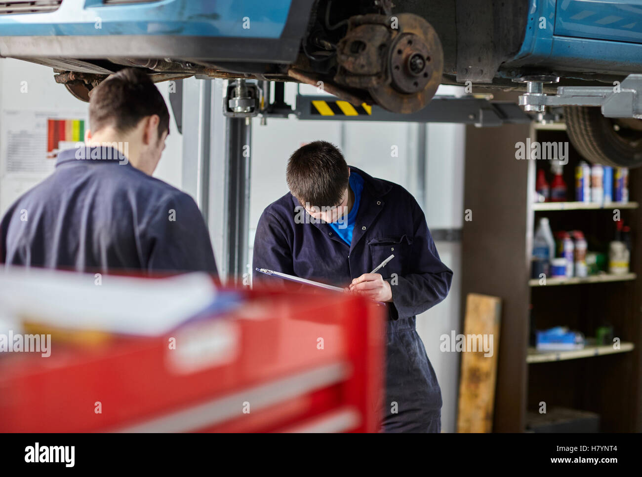 Car Servicing Mechanic MOT Motor Vehicle Engineer Testing - Stock Image