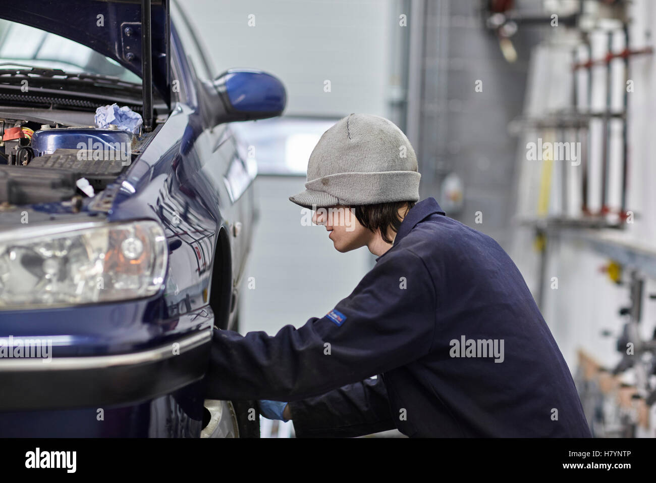Car Servicing Wheel Change Tyre MOT Motor Vehicle Testing - Stock Image