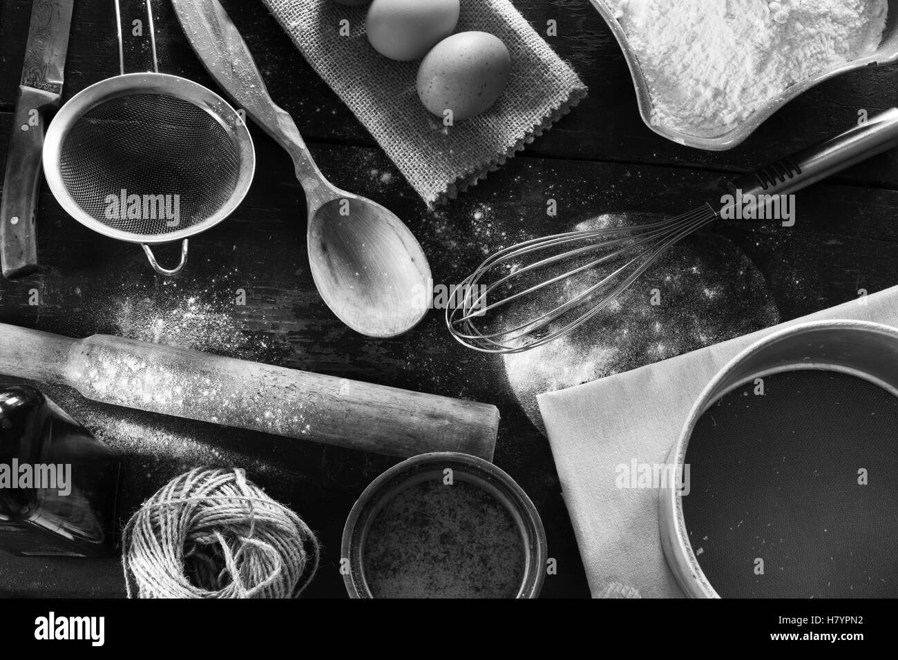 A set of old kitchen items close-up view from above. Kitchen table in a rustic style. Products for baking flour, - Stock Image