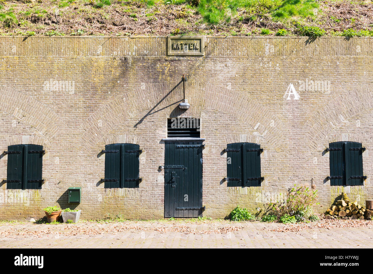 Entrance to barrack on bastion Katten in old fortified town of Naarden, North Holland, Netherlands - Stock Image
