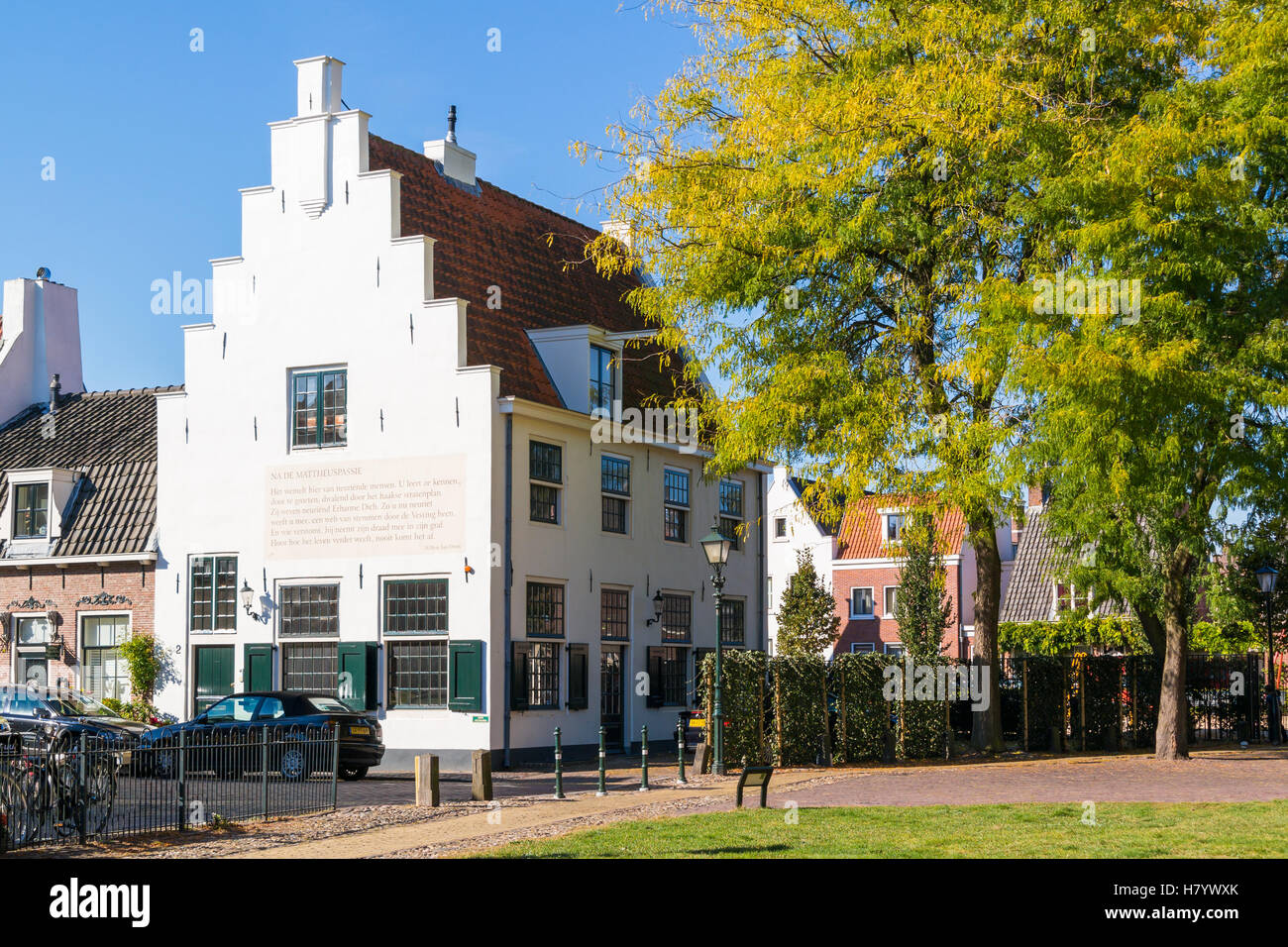 Historic white house with stepped gable in old town of Naarden, North Holland, Netherlands - Stock Image
