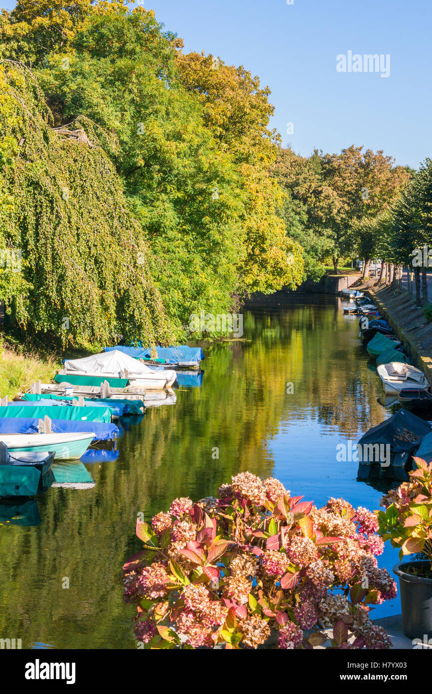 Canal with boats in autumn in old town of Naarden, North Holland, Netherlands - Stock Image