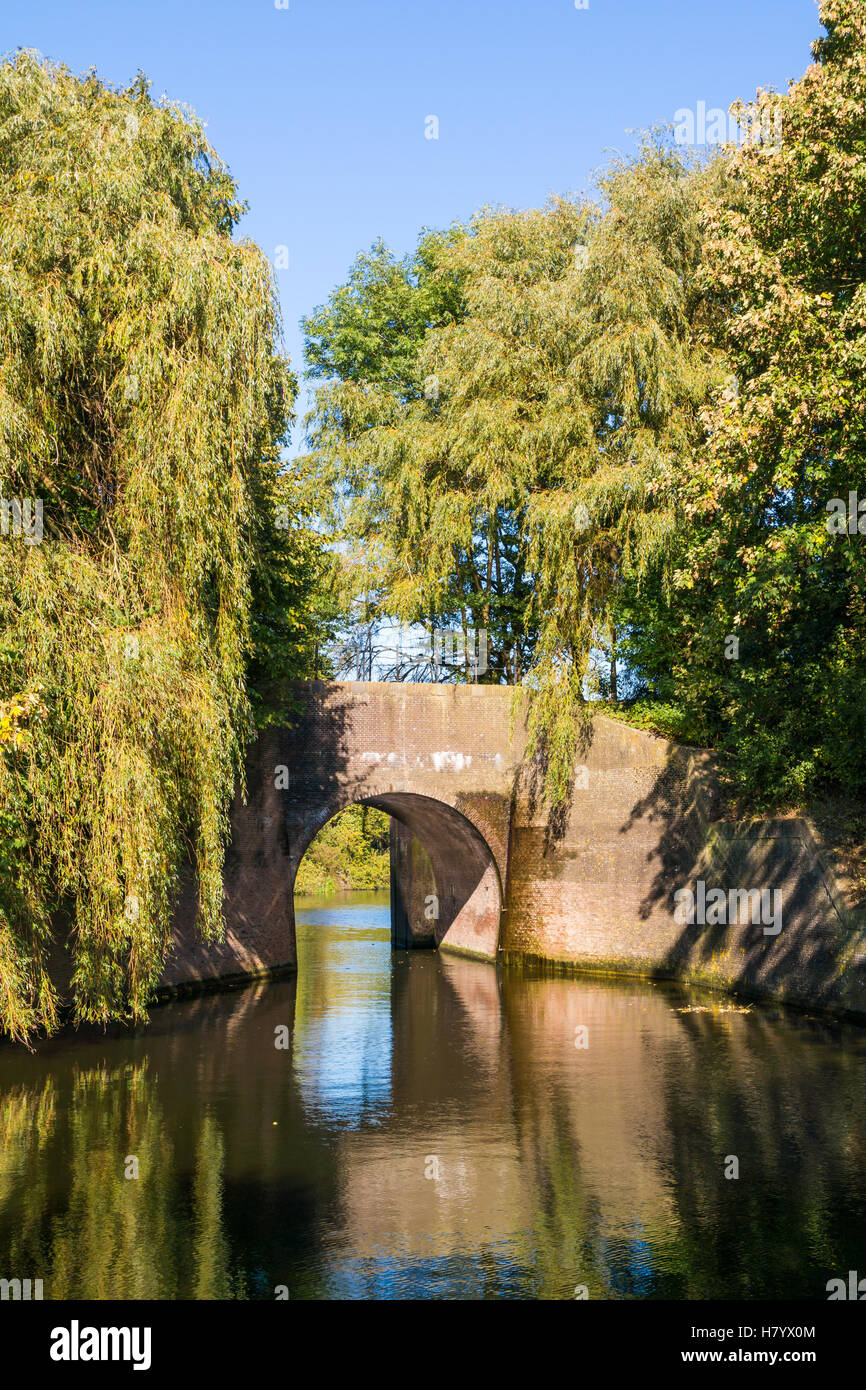 Canal and bridge in autumn in old fortified town of Naarden-Vesting, North Holland, Netherlands - Stock Image