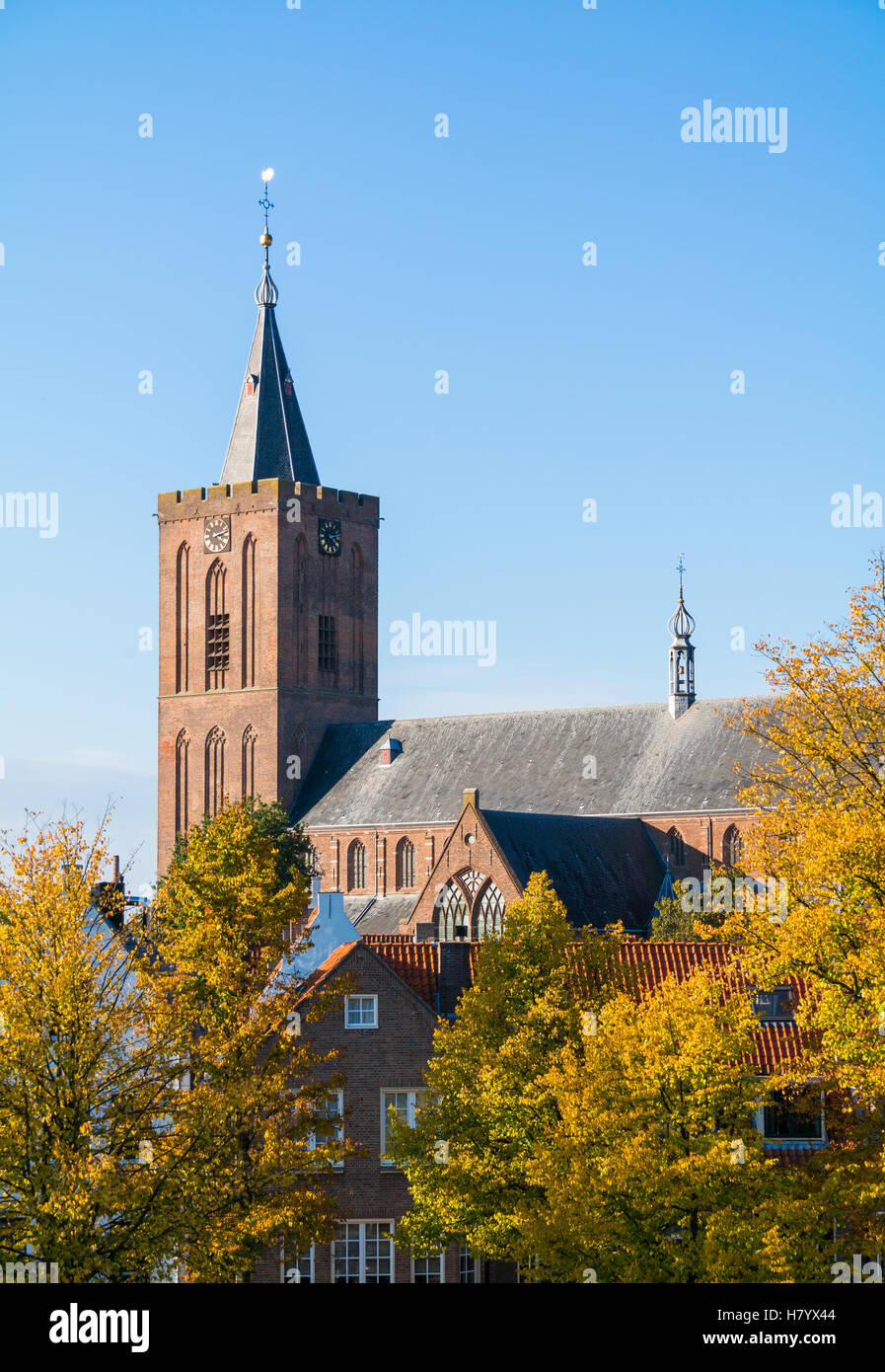 Big Church or Saint Vitus Church and old houses in autumn in Naarden-Vesting, North Holland, Netherlands - Stock Image