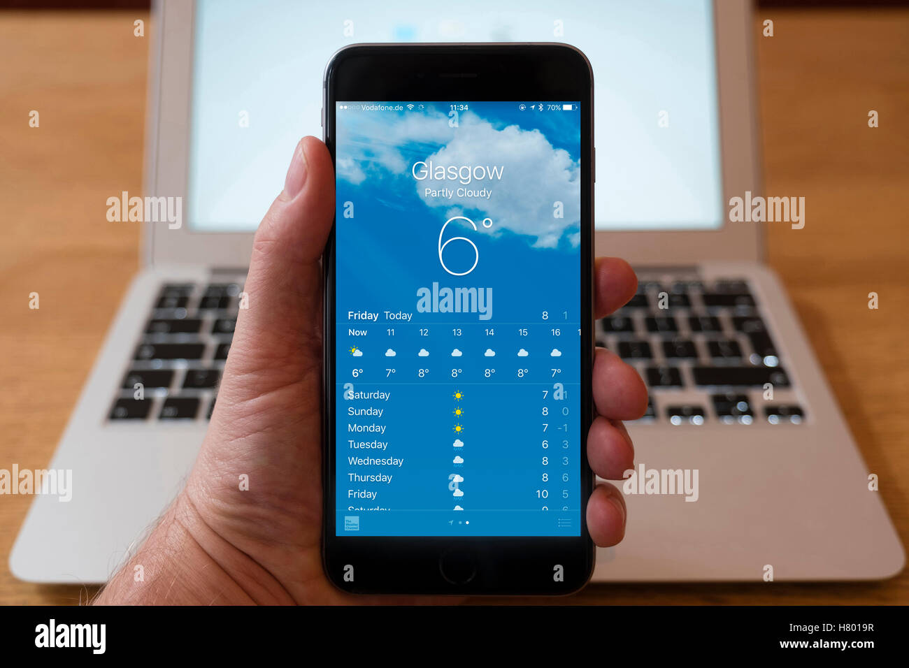 Using iPhone smart phone to display weather forecast for Glasgow, UK - Stock Image