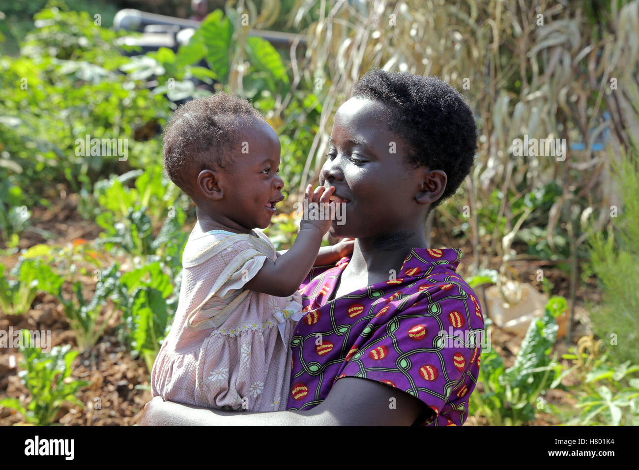Mother (17) with her baby boy (8 month). Refugees from the Congo in the UNHCR Kigeme refugee camp. Diocese of Gikongoro, - Stock Image