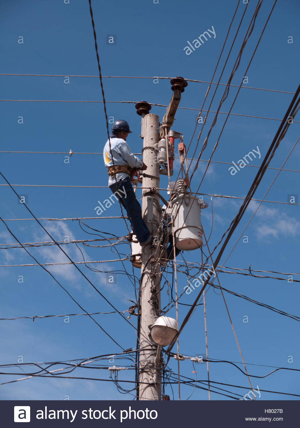 Power company workers exchanging a transformer in Jinotega