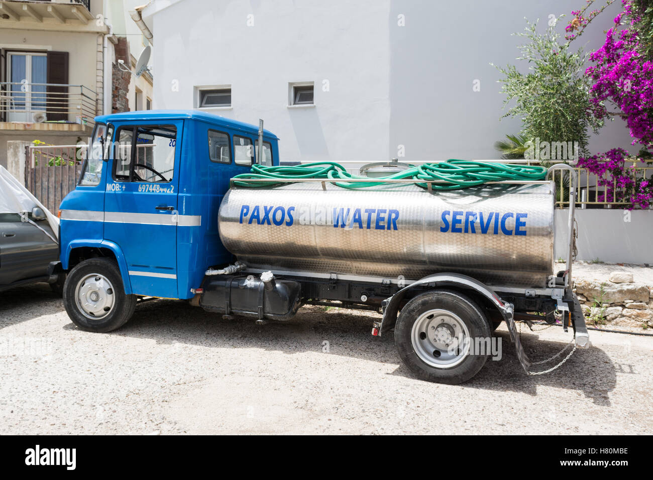water service lorry in Gaios, Paxos, Greece - Stock Image
